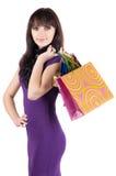 кладет красивейшую shoping женщину в мешки Стоковая Фотография