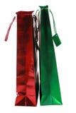 кладет красный цвет в мешки подарка зеленый Стоковое Изображение RF