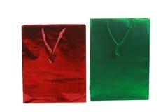 кладет красный цвет в мешки подарка зеленый Стоковые Фотографии RF
