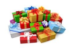 кладет кучу в коробку цветастого подарка счастливую Стоковые Изображения