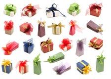 кладет подарок в коробку собрания причудливый Стоковая Фотография
