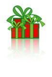 кладет подарок в коробку Стоковые Фотографии RF