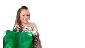 кладет покупку в мешки девушки милую Стоковая Фотография