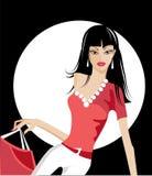 кладет покупку в мешки девушки милую Стоковое Изображение RF
