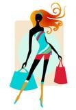 кладет покупку в мешки девушки милую Стоковое Фото