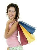 кладет покупку в мешки девушки Стоковое фото RF