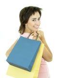 кладет покупку в мешки девушки Стоковые Фотографии RF