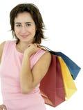 кладет покупку в мешки девушки стоковые изображения rf