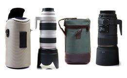 кладет профессионала в мешки объектива фотоаппарата стоковое фото rf