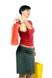 кладет счастливую женщину в мешки покупкы Стоковые Фотографии RF