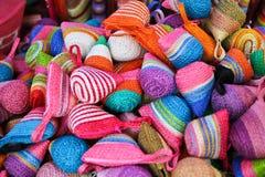 кладет цветастое в мешки Стоковые Фото