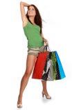 кладет цветастую женщину в мешки покупкы стоковое фото