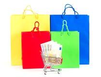 кладет цветастую покупку в мешки принципиальной схемы Стоковая Фотография