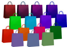 кладет цветастую покупку в мешки Стоковые Фото