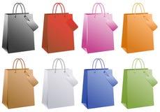 кладет цветастую покупку в мешки Стоковое Фото