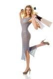 кладет шикарную смотря женщину в мешки покупкы вы Стоковое Фото