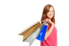 кладет shoping детенышей в мешки женщины Стоковые Фотографии RF