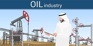 клапаны рядка газовой промышленности красные Арабский человек контролирует производственный процесс стоковая фотография