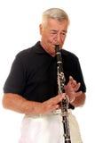 кларнет играя старший Стоковые Изображения