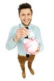 класть дег человека банка piggy стоковые изображения rf