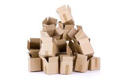 кладет кучу в коробку картона пустую Стоковые Фото