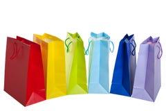 кладет покупку в мешки радуги Стоковое Изображение
