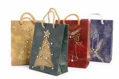 кладет покупку в мешки рождества Стоковая Фотография RF
