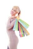 кладет счастливую женщину в мешки покупкы удерживания Стоковое фото RF