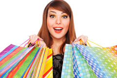 кладет счастливых детенышей в мешки женщины покупкы Стоковые Изображения