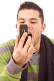 Клекот молодого человека к телефону Стоковые Фотографии RF