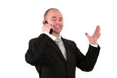 клетка бизнесмена обсуждая детенышей телефона Стоковые Изображения