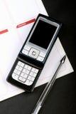 клетчатый телефон тетради Стоковые Изображения RF
