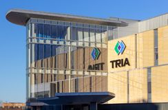 Клиника TRIA протезные и логотип товарного знака стоковое изображение rf