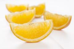 Клин апельсина на белой предпосылке Стоковая Фотография