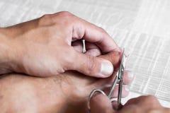 Клиппирование ногтя стоковое изображение