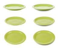 клиппирование dishes изолированные зеленым цветом плиты путя стоковые изображения rf