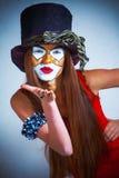 Клоун девушки с покрашенной стороной. Стоковое Фото