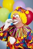 клоун испытывающий жажду Стоковая Фотография RF