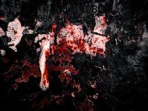 Клочки бумаги на металле на черном и красном стоковая фотография rf