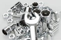 Ключ, гнезда ключа, винты болта и гайки закрывают Стоковые Изображения