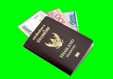 Книга и банкнота пасспорта Таиланда Стоковая Фотография