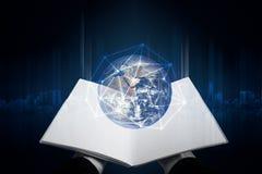 Книга и глобальный раскрытые рукой с сетевым подключением Элементы этого изображения поставлены NASA стоковые изображения rf