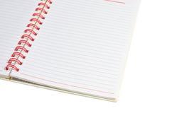Книга и красный связыватель Стоковые Изображения