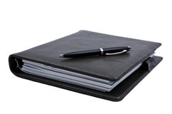 Книга и ручка Стоковые Изображения RF