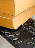 Книга на клавиатуре Стоковая Фотография RF
