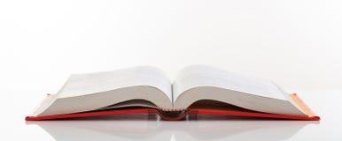 Книга открытая на белой предпосылке Стоковые Фотографии RF