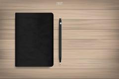 Книга памяти с черной текстурой крышки и карандаш на деревянной предпосылке иллюстрация вектора