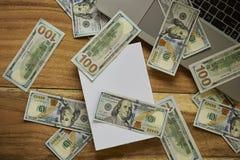 Книга с деньгами и компьтер-книжкой Стоковые Изображения RF