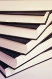 Книги делают по образцу на белизне Стоковое Изображение