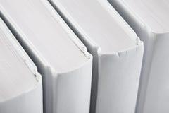 книги задних частей закрывают вверх по белизне Стоковая Фотография RF
